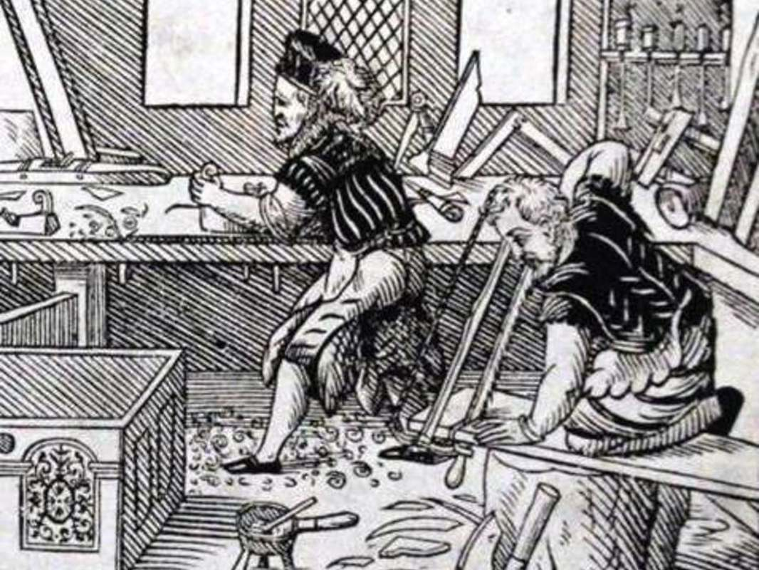 Woodcut of people working in an early modern shop